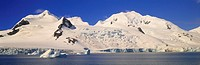 Panoramic view of glaciers and iceberg