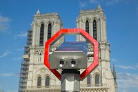 Binoculars pointed at Notre Dame Cathedral