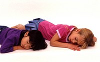 Two girls sleeping on floor