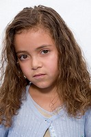 Portrait of Hispanic girl frowning