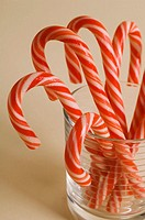 Christmas candy canes in clear glass
