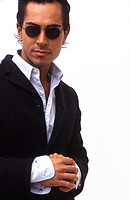 Portrait of an attractive Hispanic male wearing sunglasses