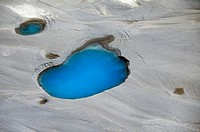 Aerial view of silt and turquoise water in an Alaska glacier