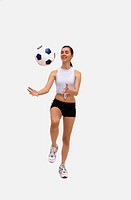 Caucasian female playing with soccer ball