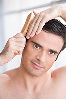 Man combing his hair