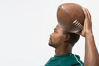 Man throwing american football (thumbnail)