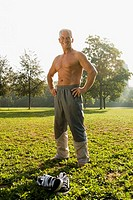 healthy mature man resting in park after exercising