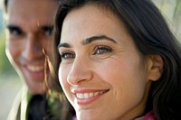 close-up portrait of couple with woman smiling