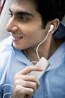 Man Listening to MP3 Player
