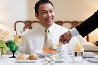 Dinner is Being Served to Businessman