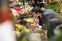 Businessman Smelling Bouquets