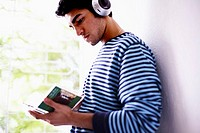 Young Man Listening to Music on Headphones