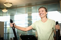 Woman Exercising on an Elliptical Trainer (thumbnail)