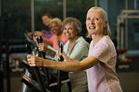 Women Exercising on an Elliptical Trainer