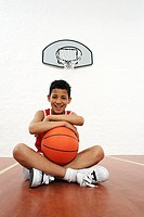 Basketball Player Sitting on the Floor