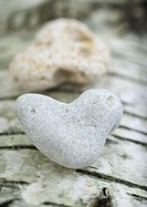 Heart shaped stones on bark background, extreme close-up
