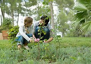 Mother and daughter gardening together