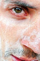 Man with soap lather on face