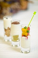 Yoghurt glasses: white grape and cacao powder - Diced sweet pepper - Crunchy cereals and black chocolate leaves