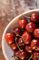 Many fresh cherries in a bowl