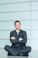 Businessman sitting with his arms crossed