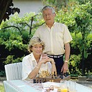 Mature couple's portrait in garden
