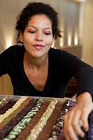 Woman browsing chocolates for sale