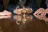 Colleagues around a smoking genie lamp