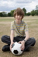 Teenage boy with a football