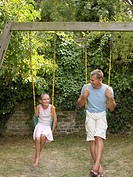 Father and daughter playing on swings (thumbnail)