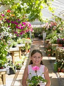 Girl standing in a garden centre