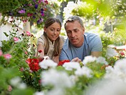 Father and daughter looking at flowers