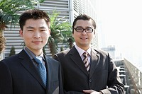 Businessmen standing outdoors