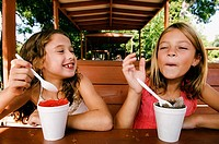 Two girls eating shaved ice