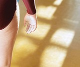 Close-up of a female gymnast standing with chalk on her hand