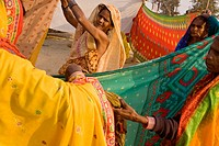 women drying up their saris after the holy bath in the sacred Ganges.  A colorful scene