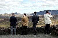 Men against a picturesque mountain landscape