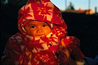 Closeup view of baby wearing the red coat