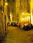 View of people sitting at a restuarant and enjoying dinner