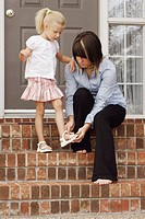 Helping young girl with shoes