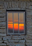 Sunset viewed through a window