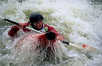 A person rafting in river