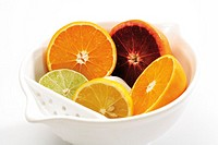 Sliced citrus fruits in bowl