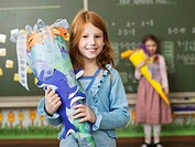 Girl holding schoolcone