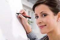 Woman working on flipchart