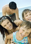 Family laughing on beach, close-up