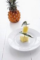 still life of pineapple pieces on plate