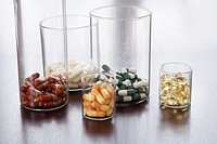 different pills and capsules in glass jars