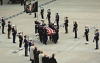 Former President Gerald R. Ford's casket is carried from the aircraft by the Armed Forces Honor Guard after arriving Jan. 2 at the Gerald R. Ford Inte...