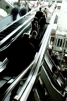 Group of passengers on an escalator